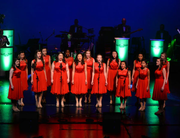 Show choir in red dresses