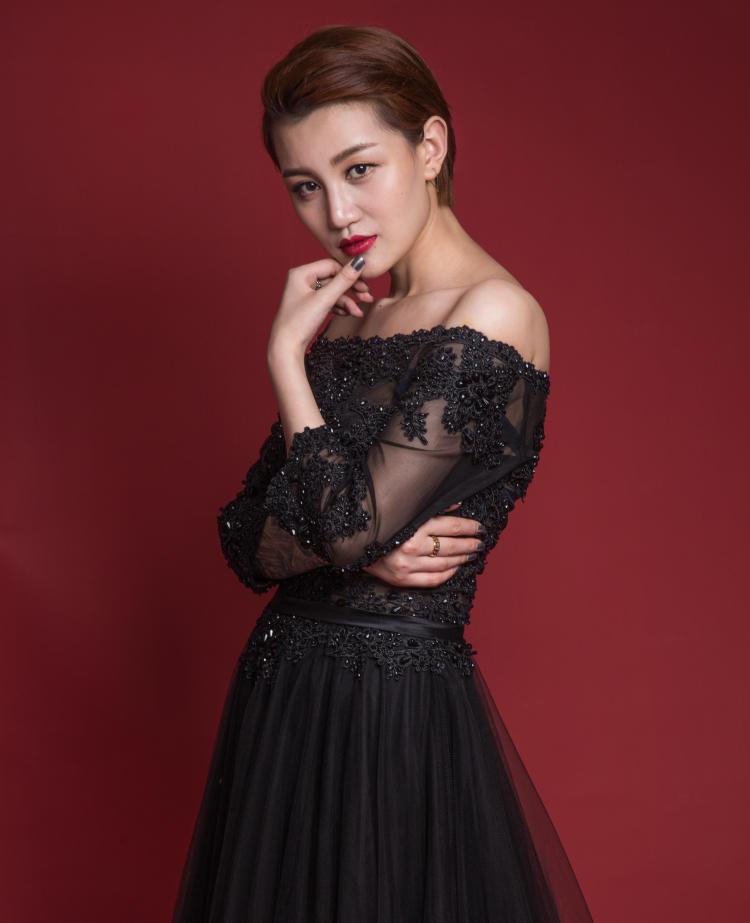 concert black dresses on a singer