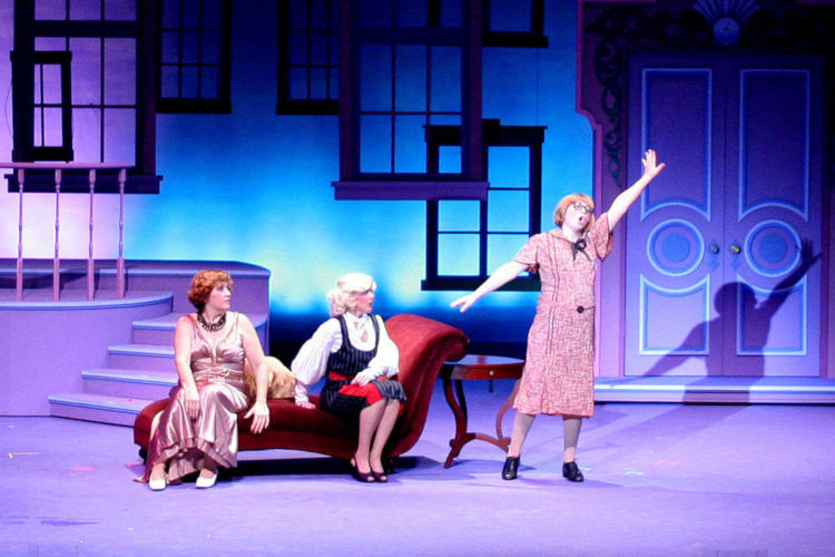 Actors performing one of the best musicals for community theater