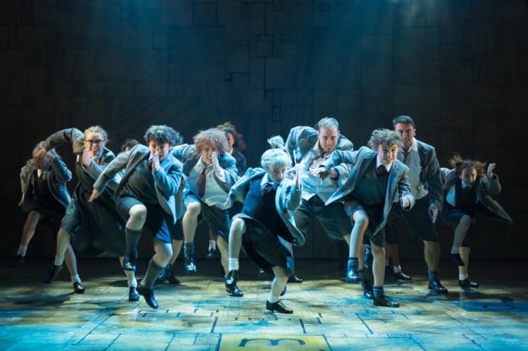 High-school age performers onstage in Matilda the musical