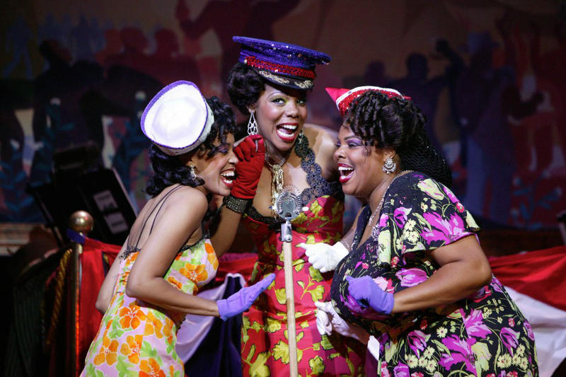 three female singers performing in musical theater
