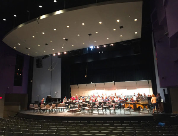 stage set up for orchestra and singers in a sitzprobe